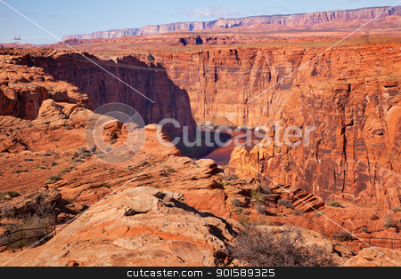 Electric Lines Over Colorado River Glen Canyon Dam Arizona stock photo, Electric Lines Over Colorado River Orange Canyon Downstream from Glen Canyon Dam Arizona.   by William Perry