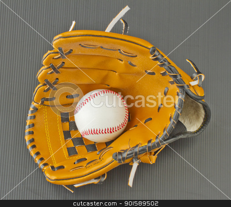 Baseball and glove stock photo, Baseball inside a leather glove over black by Fabio Alcini