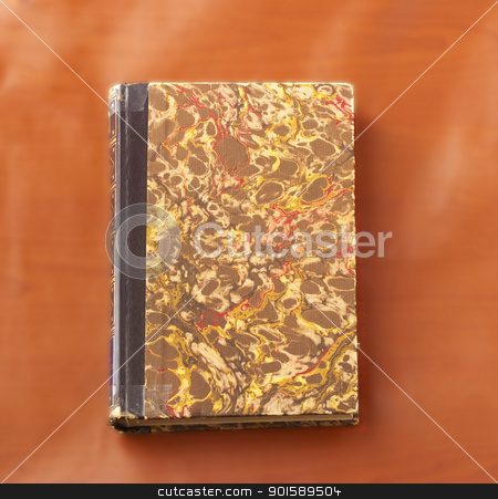 Book stock photo, Old hardcovered book over wooden background by Fabio Alcini