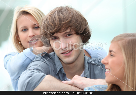 Three smiling teenagers sitting together stock photo, Three smiling teenagers sitting together by photography33