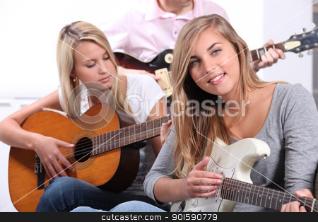 Teenagers playing the guitar stock photo, Teenagers playing the guitar by photography33