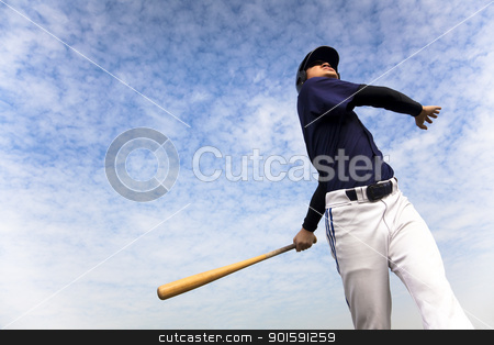 baseball player taking a swing with cloud background stock photo, baseball player taking a swing with cloud background by tomwang
