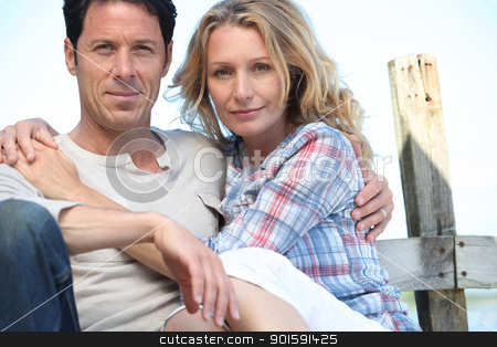 Relaxed mature couple sitting in the sunshine stock photo, Relaxed mature couple sitting in the sunshine by photography33