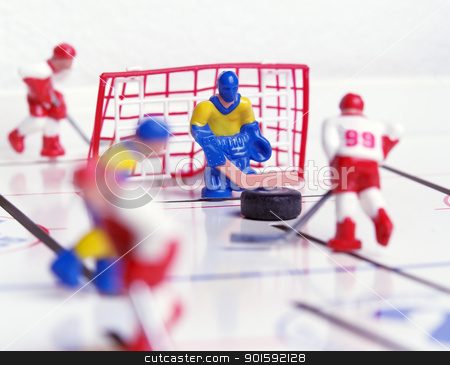 Hockey Toy stock photo, Hockey game with selective focus by Anne-Louise Quarfoth