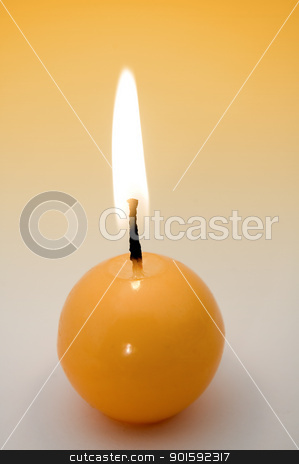 candle stock photo, small yellow burning candle, yellow to grey background by Robert Remen