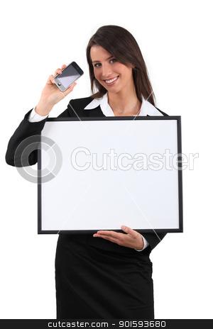 Businesswoman showing phone stock photo, Businesswoman showing phone by photography33