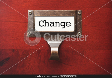 Lustrous Wooden Cabinet with Change File Label stock photo, Lustrous Wooden Cabinet with Change File Label in Dramatic LIght. by Andy Dean