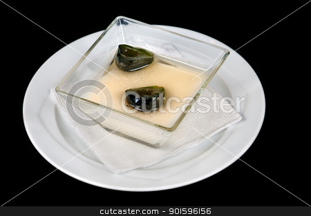 Panna cotta stock photo, Panna cotta Italian cream with green figs isolated on black background by borojoint