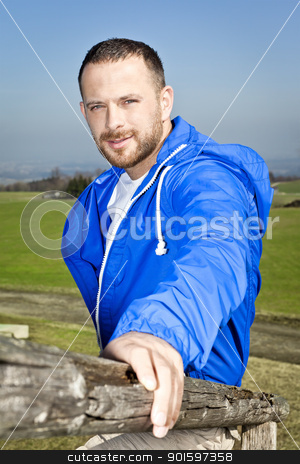 man with beard stock photo, An image of a handsome man with a beard in a blue outdoor clothing by Markus Gann