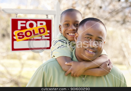 Father and Son In Front of Sold Real Estate Sign stock photo, Happy African American Father and Son in Front of Sold Real Estate Sign. by Andy Dean