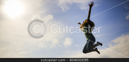 Jumping for Joy! stock photo, A young girl jumping on the trampoline on a warm spring day by Benjamin Krey Shurts
