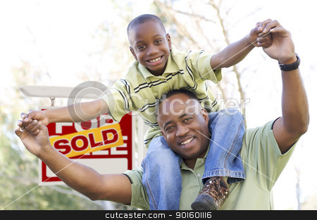 Father and Son In Front of Real Estate Sign stock photo, Happy African American Father and Son in Front of Sold Real Estate Sign. by Andy Dean
