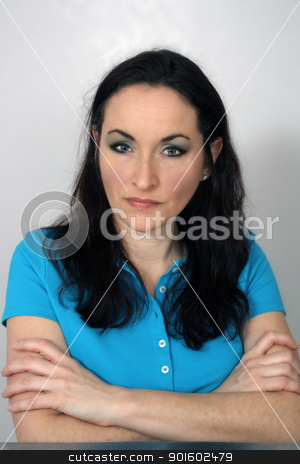 Lovely Serious Brunette (1) stock photo, A close-up of a lovely brunette with a serious facial expression and arms crossed. by Carl Stewart