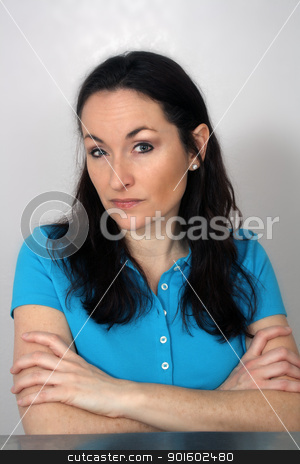 Lovely Serious Brunette (2) stock photo, A close-up of a lovely brunette with a serious facial expression and arms crossed. by Carl Stewart