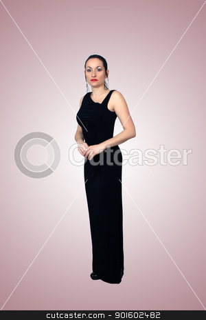 Beautiful Brunette Wearing a Long Black Dress (1) stock photo, A lovely brunette wearing a long black dress, isolated on a gradient pink background.  Generous copyspace. by Carl Stewart