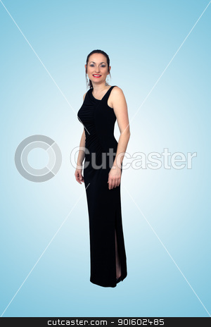 Beautiful Brunette Wearing a Long Black Dress (2) stock photo, A lovely brunette wearing a long black dress, isolated on a gradient teal background.  Generous copyspace. by Carl Stewart