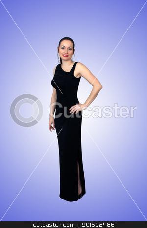 Beautiful Brunette Wearing a Long Black Dress (3) stock photo, A lovely brunette wearing a long black dress, isolated on a gradient blue background.  Generous copyspace. by Carl Stewart