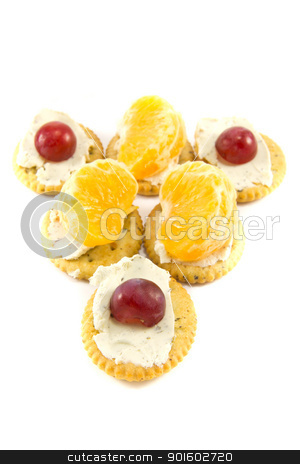Cracker ship stock photo, Picture of some crackers with cheese with some grapes and clementins on top by Stian Olsen