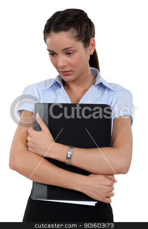Brunette unhappy with her job stock photo, Brunette unhappy with her job by photography33