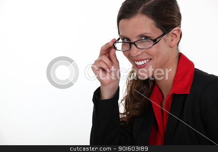 A portrait of businesswoman adjusting her glasses. stock photo, A portrait of businesswoman adjusting her glasses. by photography33