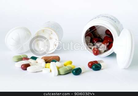 Tablets and capsules with two bottles stock photo, Different forms and colours tablets and capsules and two white bottles by Iryna Rasko