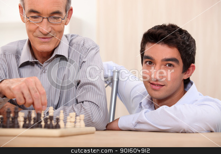 Father and son playing chess stock photo, Father and son playing chess by photography33