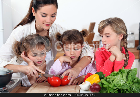mother and her daughters making salad stock photo, mother and her daughters making salad by photography33