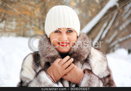 Beautiful young woman in winter coat stock photo, Portrait of beautiful young woman in winter coat by Julialine