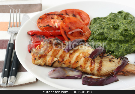 fried fish with spinach stock photo, fried fish with spinach by nataliamylova