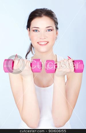 woman doing fitness exercises stock photo, Young woman doing fitness exercises by iMarin