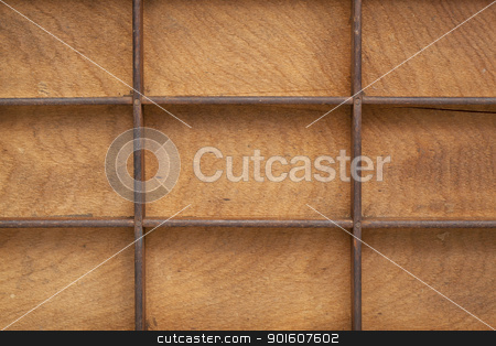 grunge wood texture with grid stock photo, detail of vintage grunge wood typesetter drawer with dividers by Marek Uliasz