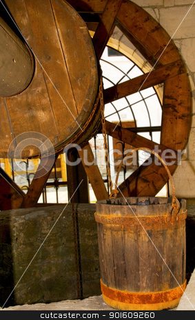 Old wooden well and bucket stock photo, Old wooden and bucket with rusty rings by Iryna Rasko