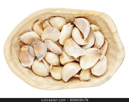 garlic cloves stock photo, garlic cloves in a rustic wood bowl isolated on white by Marek Uliasz