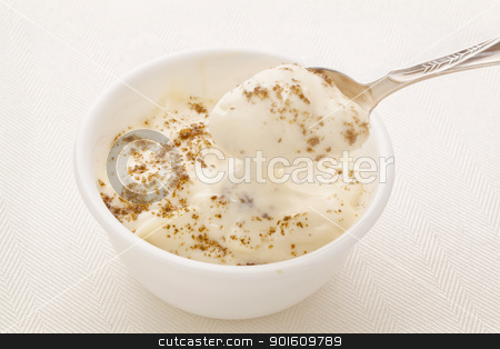 Greek yogurt with chia seeds stock photo, Greek style yogurt sprinkled  with ground chia seeds - healthy breakfast concept by Marek Uliasz