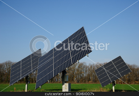 Solar panels stock photo, A group of solar panels in the green by Maurizio Martini