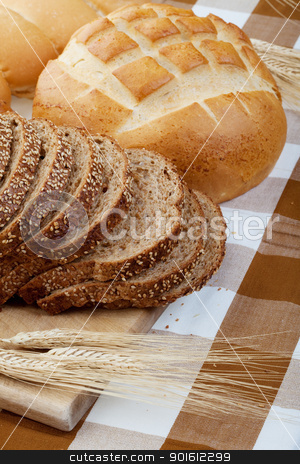 Bread stock photo, Assortment of baked bread on a table cloth with wheat by Steve Mcsweeny