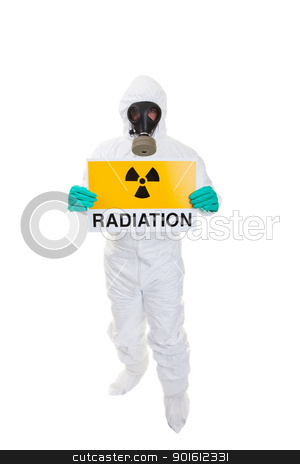 Radioactive stock photo, A man in a  hazmat suit holding a sign by Steve Mcsweeny