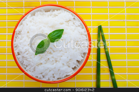 Steamed rice stock photo, Bowl of steamed rice on yellow with green bamboo chopsticks  by Steve Mcsweeny