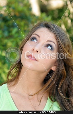 Beautiful Young Brunette, Outdoor Headshot (3) stock photo, A close-up of a lovely young brunette looking up and toward frame left. by Carl Stewart