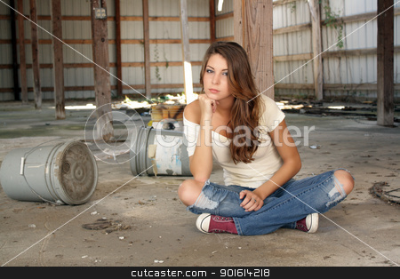 Beautiful Brunette Sitting in an Abandoned Warehouse (3) stock photo, A lovely young brunette in dress-down casual wear sits on the floor of a long-abandoned warehouse. by Carl Stewart