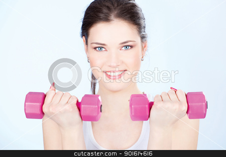woman with two weights stock photo, Young woman with two weights doing fitness exercises by iMarin