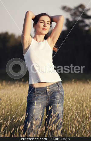 Relaxing on a summer day stock photo, Outdoor portrait of a woman on a meadow releaxing by ikostudio