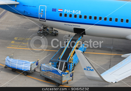 March, 24th Amsterdam Schiphol Airport loading baggage to an air stock photo, March, 24th, Amsterdam Schiphol Airport the Netherlands: loading baggage to an airplane by Porto Sabbia
