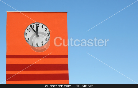 Tower clock stock photo, Six minutes till noon the tower clock is showing all of that against blue sky by vaximilian