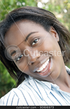 Lovely Woman, Outdoor Headshot (4) stock photo, A close-up of a lovely young black woman outdoors. by Carl Stewart