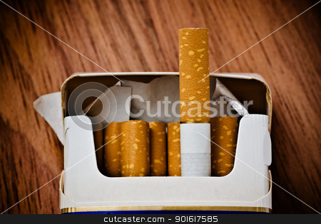 pack of cigarettes stock photo, pack of cigarettes on table by Petr Malyshev