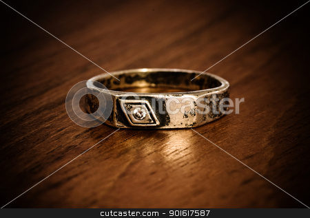 old silver ring stock photo, old silver ring on wooden table by Petr Malyshev