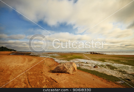 seashore with big stone stock photo, seashore with big stone under clouds by Petr Malyshev