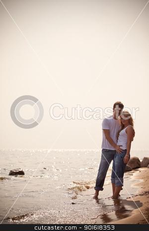 beautiful couple on a seashore stock photo, beautiful couple on a seashore, toned by Petr Malyshev