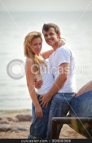 couple on a beach stock photo, beautiful couple on a beach by Petr Malyshev